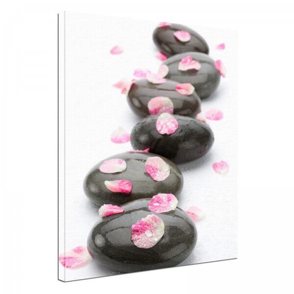 Leinwand Bild edel Blüten Blätter auf Steinen